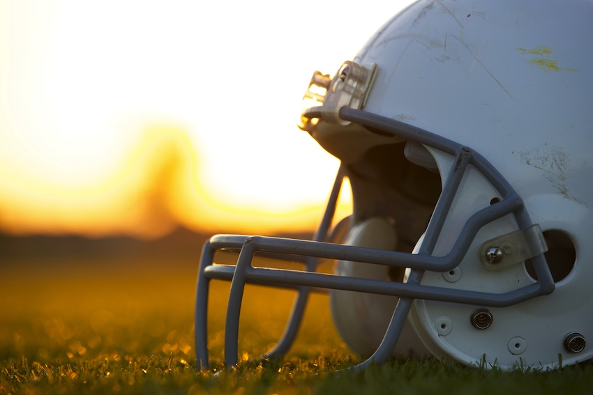 Football players are likely to experience frequent head injuries, and may be at risk for CTE. Football helmet image via Shutterstock.