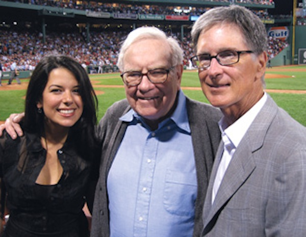 John Henry and his wife pose with (fellow newspaper entrepreneur) Warren Buffet.