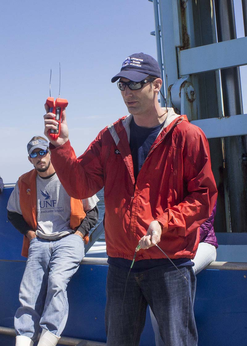 Nick Whitney, staff scientists at Mote Marine in Florida, shows off an accelerometer/ Photo by Olga Khvan