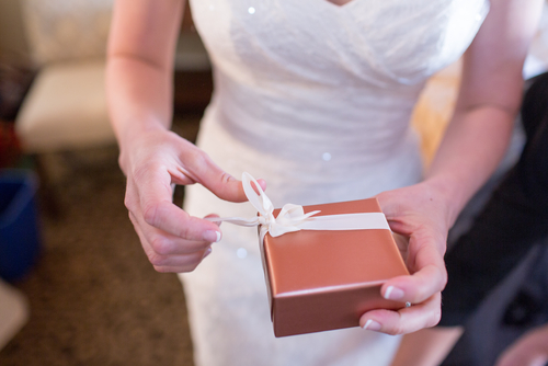 Bride Holding Gift Photo via Shutterstock