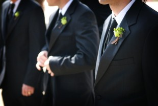 Groomsmen with boutonnieres photo via Shutterstock