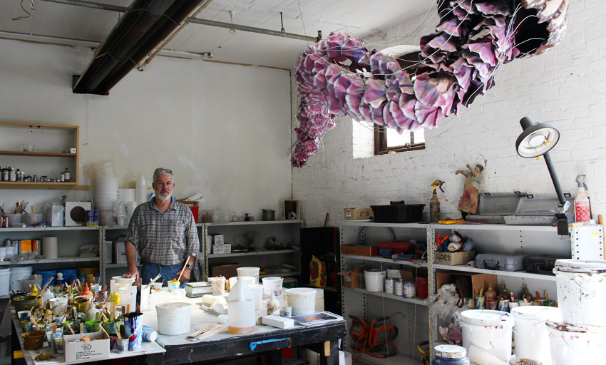 Peter Brady stands in his Charlestown studio. (Photo by Margaret Burdge)