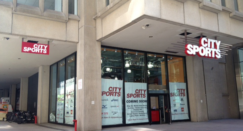 Snapshot of the outside of the new City Sports taking up space in an old bank.
