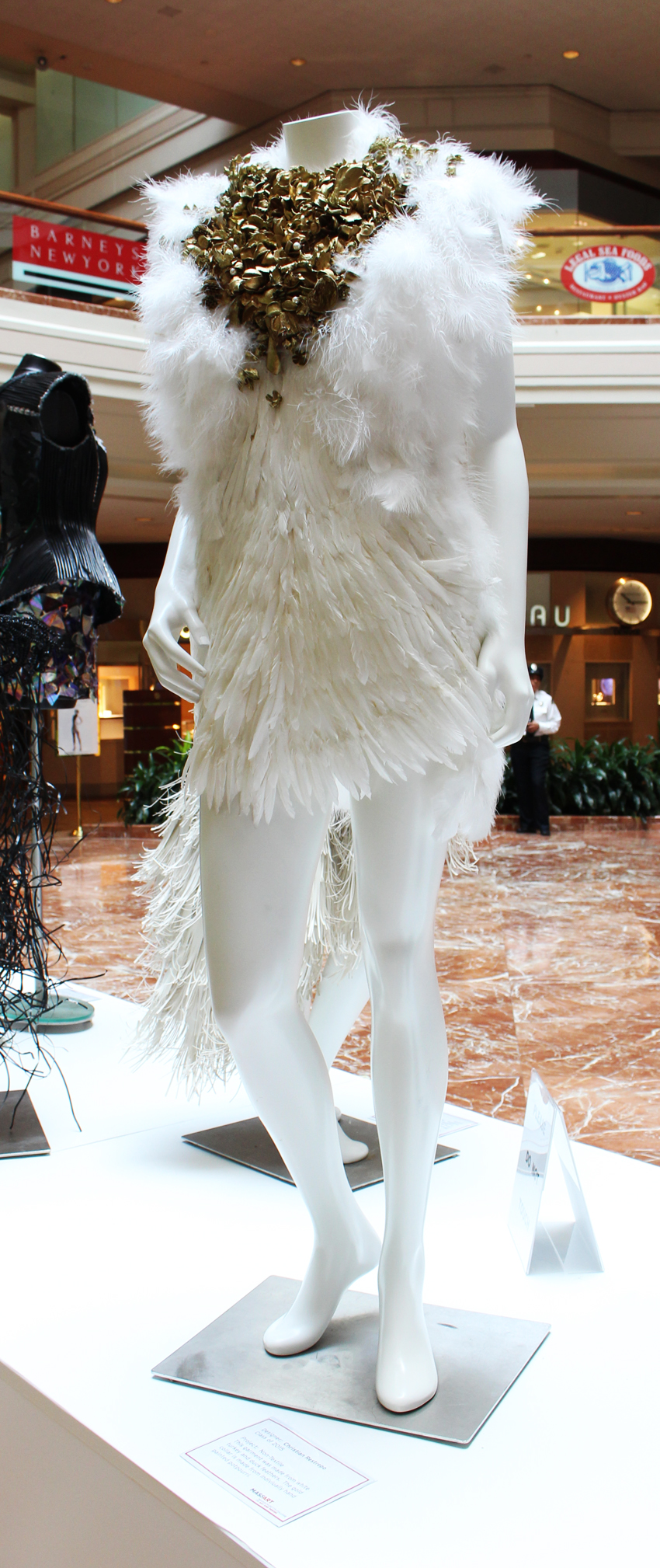 Christian Restrepo's piece made of feathers and painted potpourri wowed at the fashion show when it was modeled by a man.