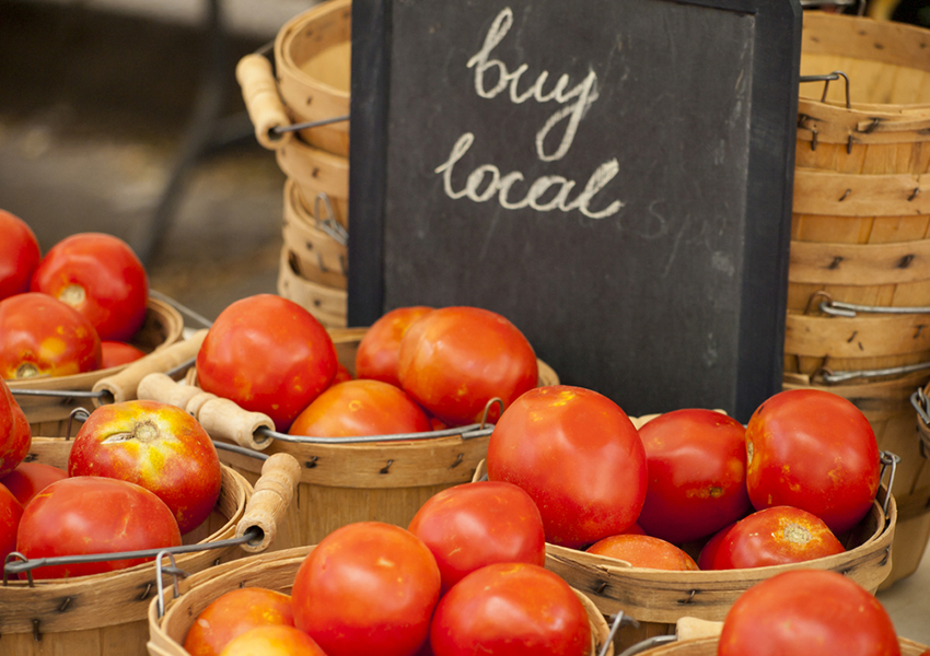 tomato stand photo via shutterstock