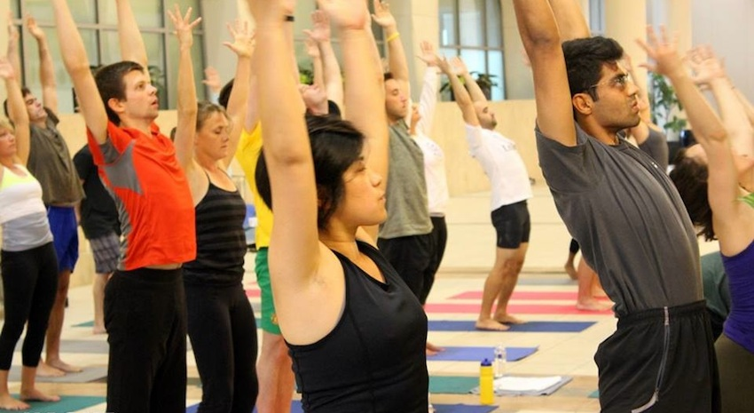 HackFit participants practice yoga on Sunday morning. Image via HackFit Facebook.