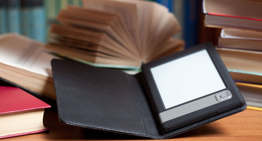 E-reader and books image via shutterstock