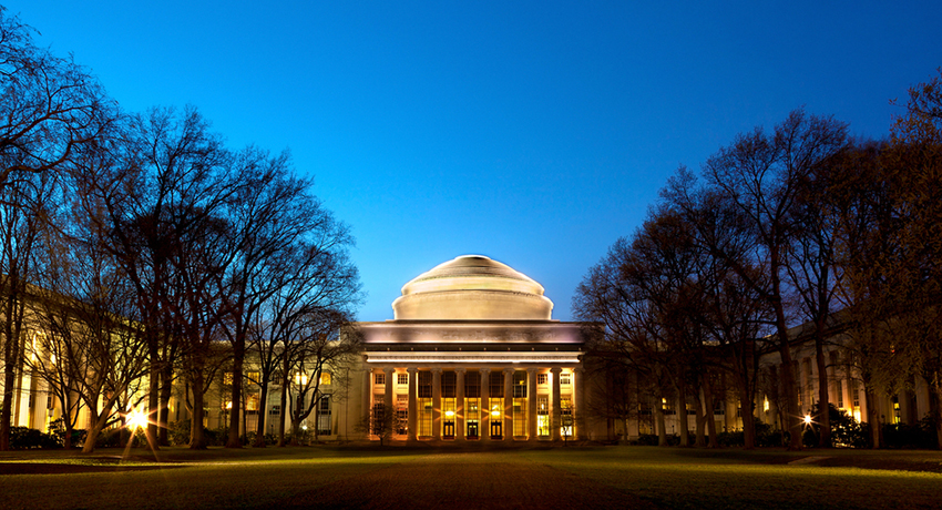 MIT at night photo via Marcio Jose Bastos Silva / Shutterstock.com