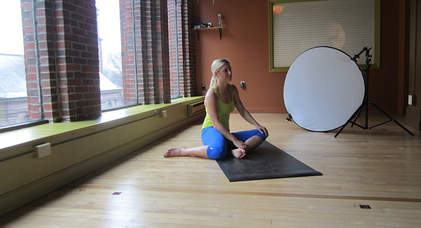 Behind the scenes at a shoot at Back Bay Yoga.