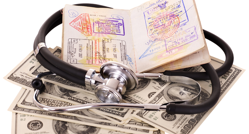 Passport, money, and stethoscope image via shutterstock