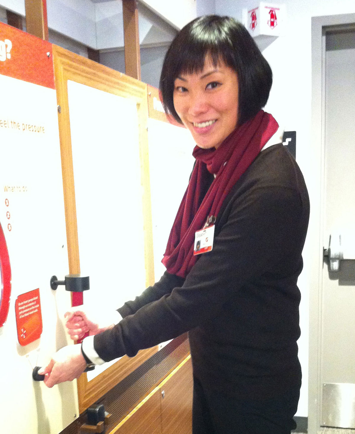 Exhibit Manager Elizabeth Kong at Hypertension Station