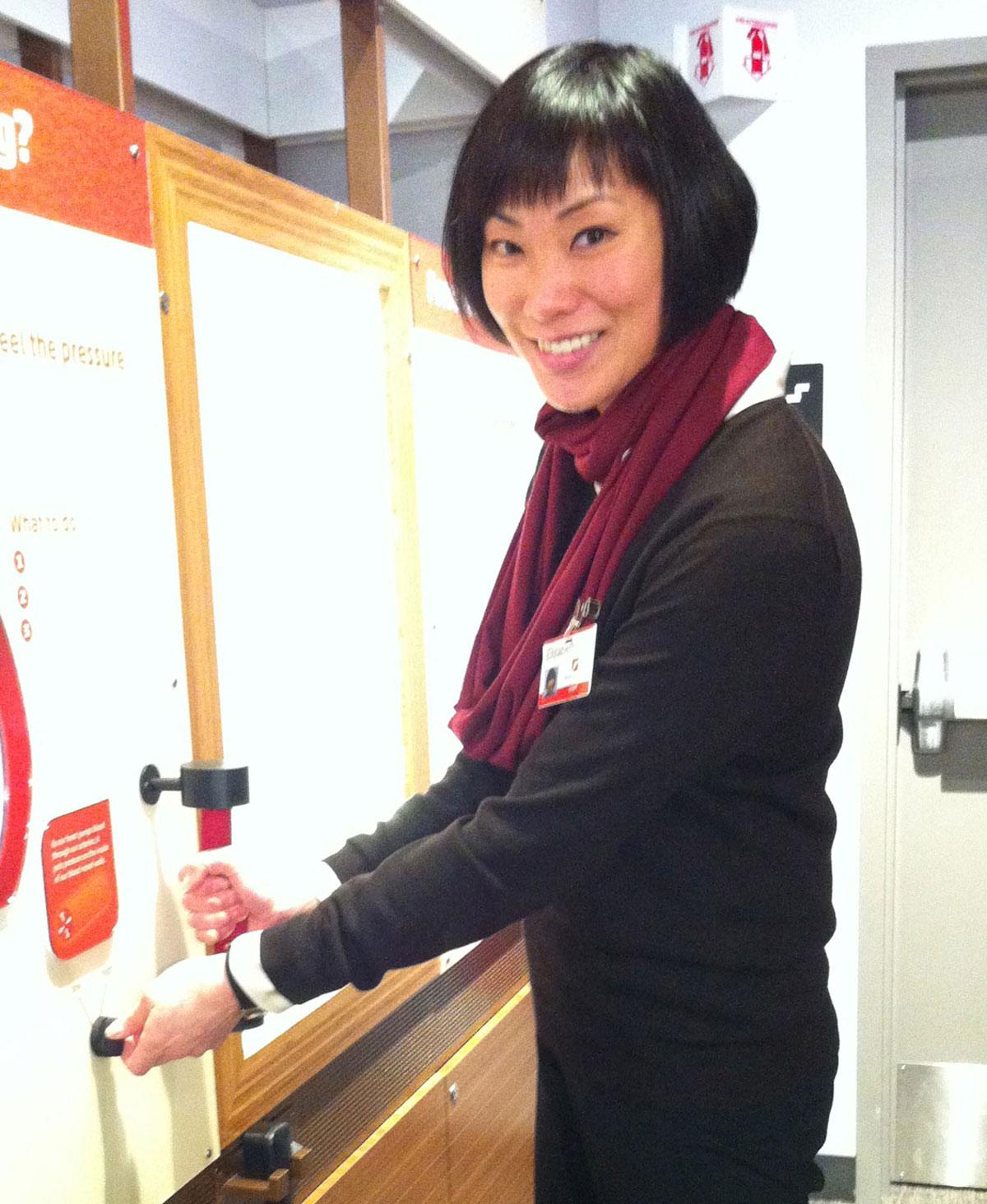 Exhibit Manager Elizabeth Kong at Hypertension Station
