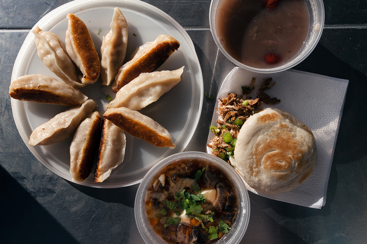 A sample of Meng's Kitchen's menu includes pan fried dumplings, savory tofu, and chopped beef sandwiches. (Photo by Alex Lau)