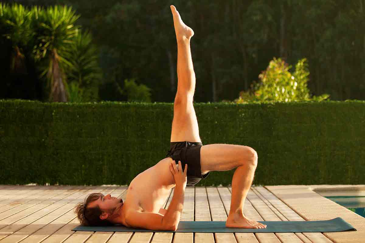 Man doing yoga image via shutterstock