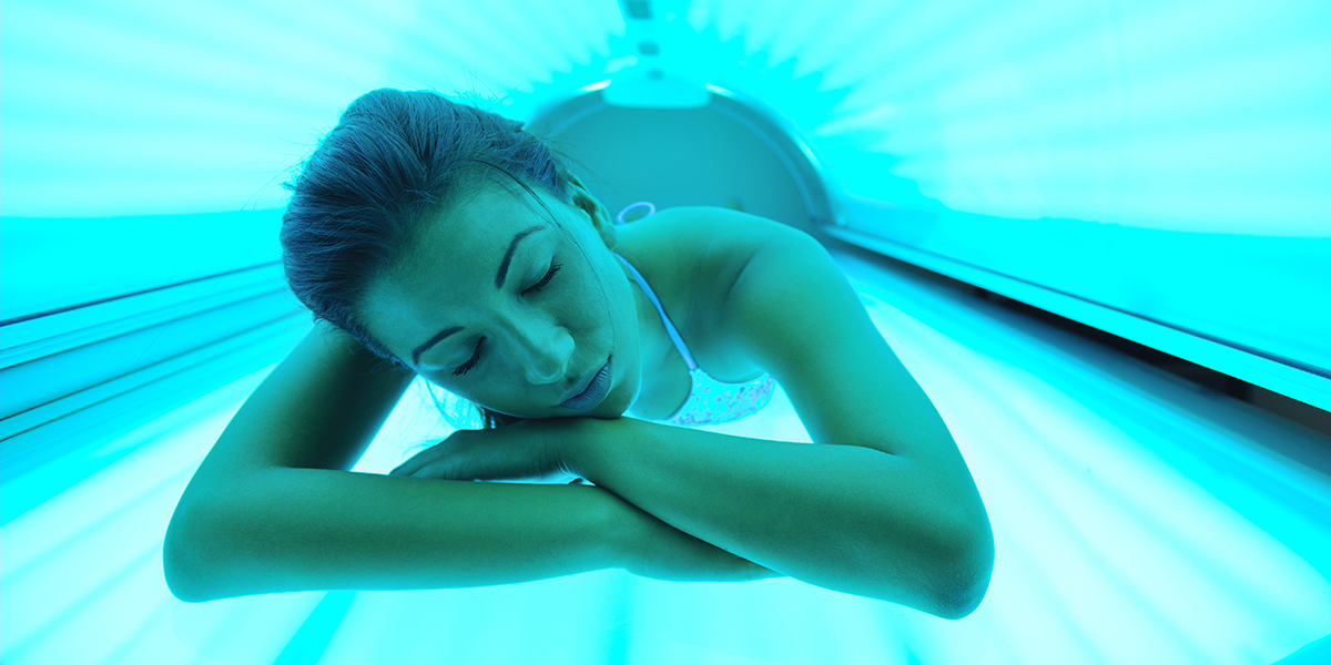 Woman in a tanning bed image via shutterstock