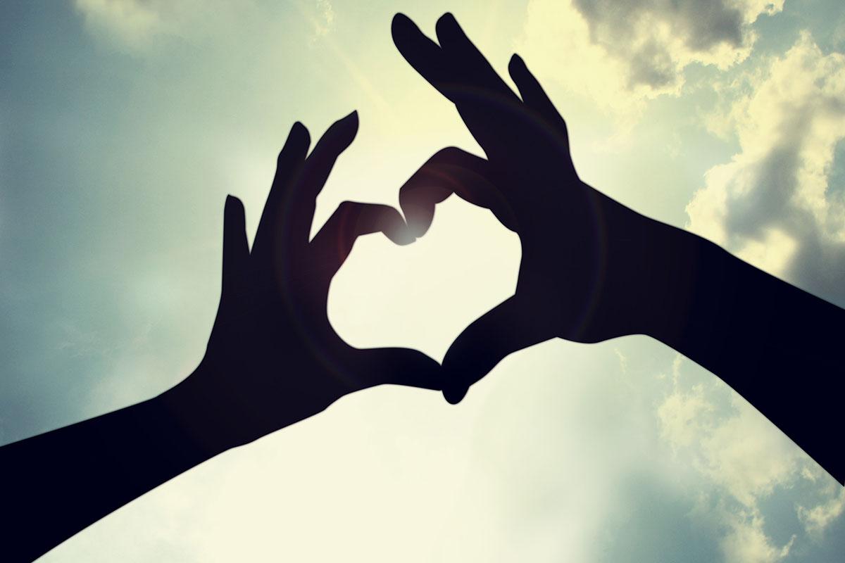 February is Heart Health month. Heart hands image via shutterstock