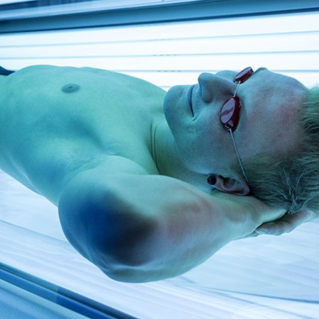 man-in-tanning-bed