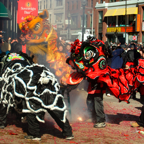 Lion Dance during Lunar New Year in Chinatown Boston. Photo via Shutterstock.