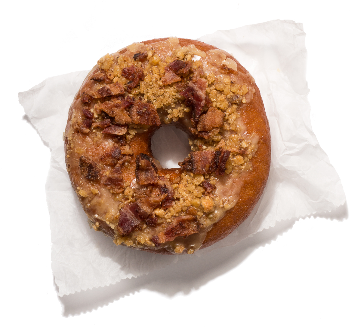 Island Creek Oyster Bar's new brown butter bacon doughnut with pecan toffee crumble. Photo by Toan Trinh