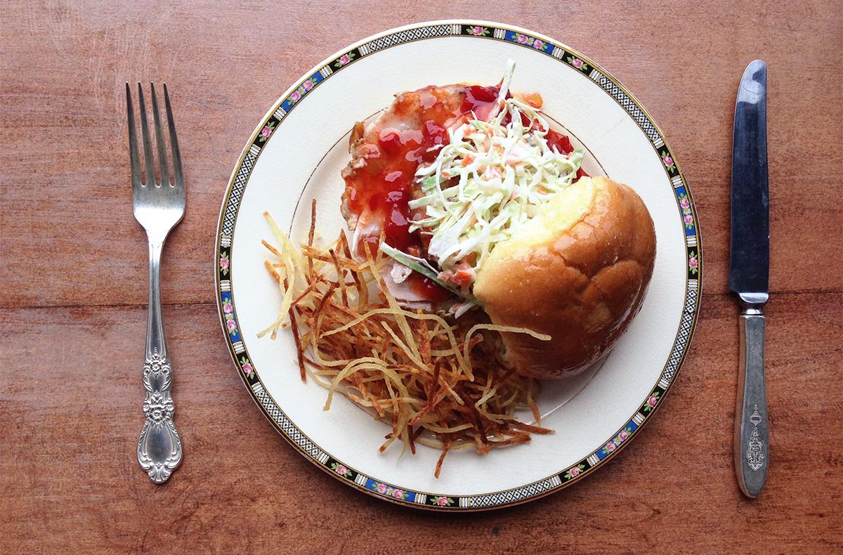 Chef Jason Albus's new pork slice sandwich with chow-chow.