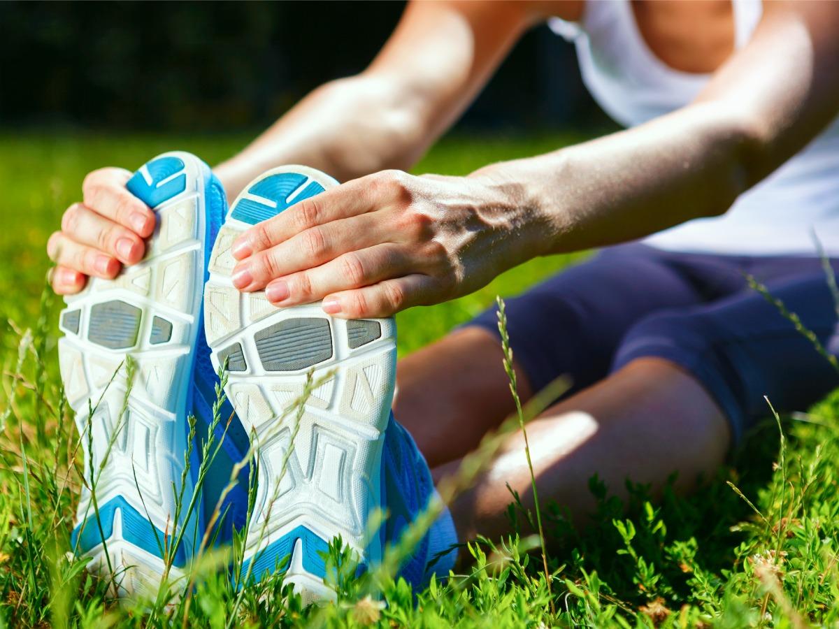 Runner Stretching Image via Shutterstock
