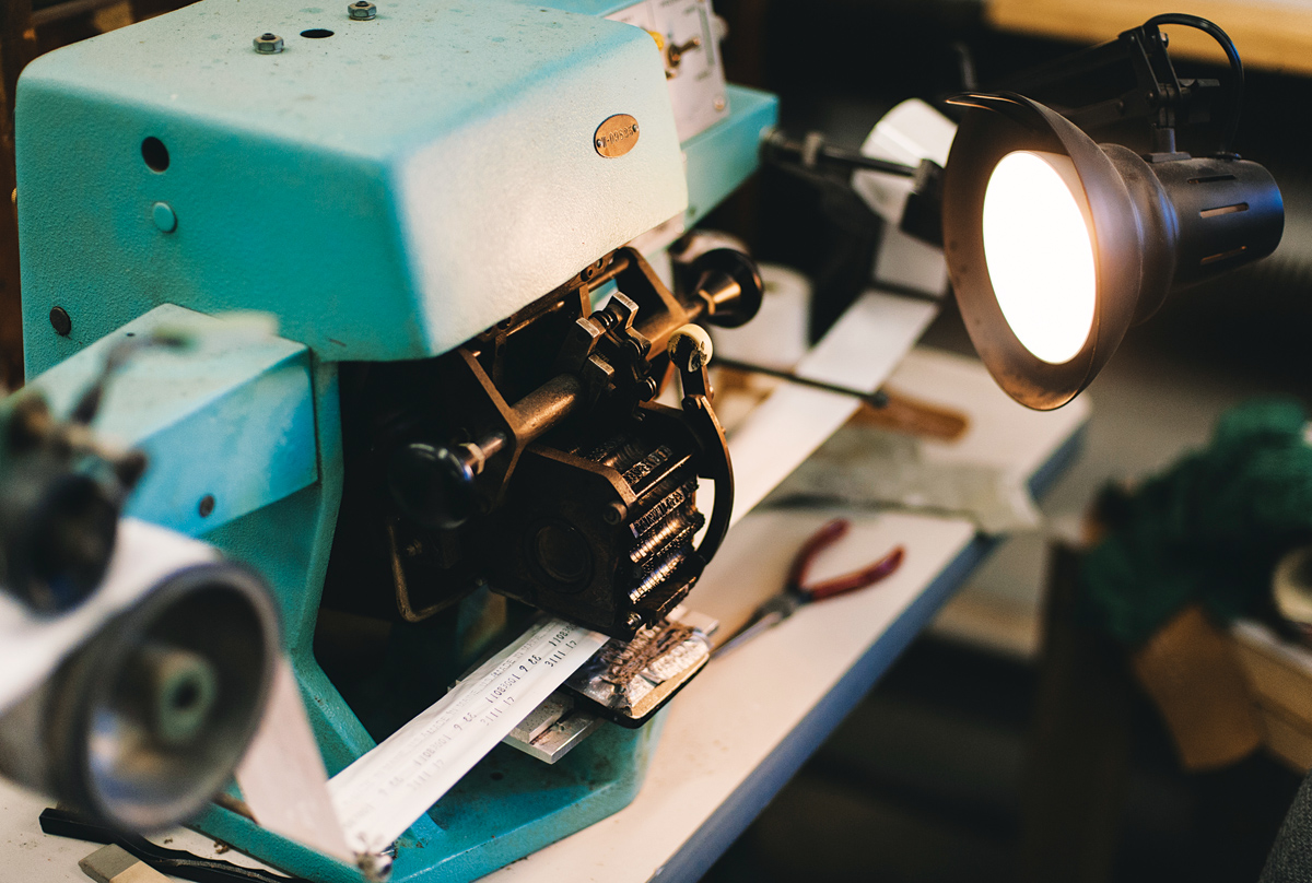 The ink-transfer machine stamps the size and lot number onto each shoe.
