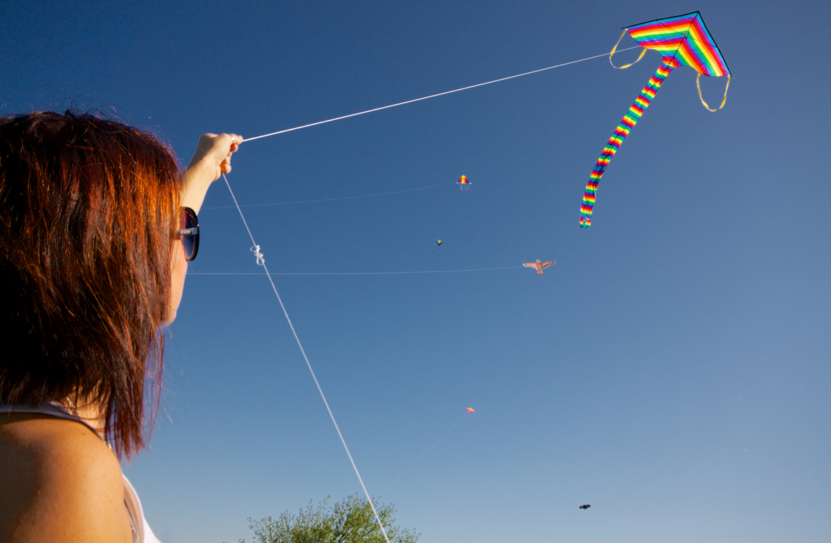A Woman Flying a Kite via Shutterstock