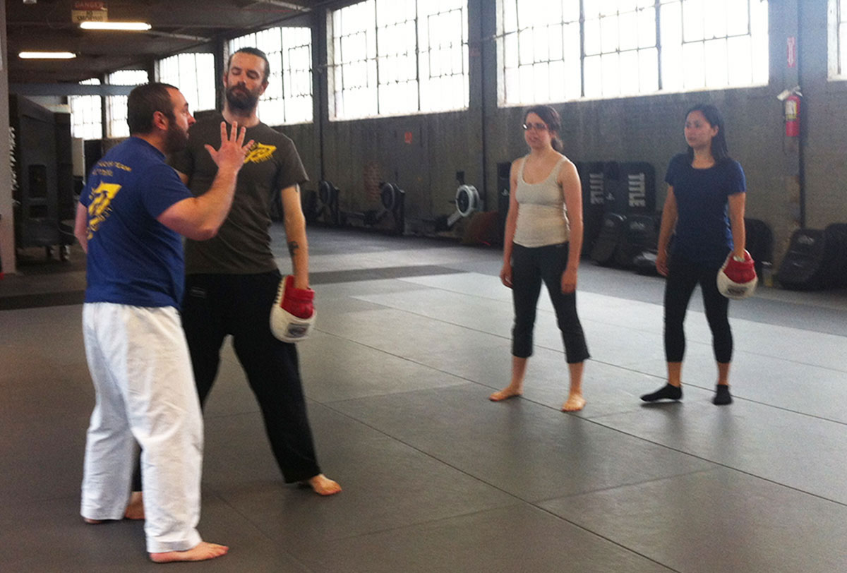 Instructor Gershon Ben Keren demonstrating a defense move with his assistant, photo by Stephanie Cohn