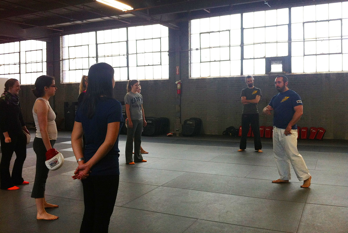 Gershon Ben Keren teaching during the physical defense part of class.