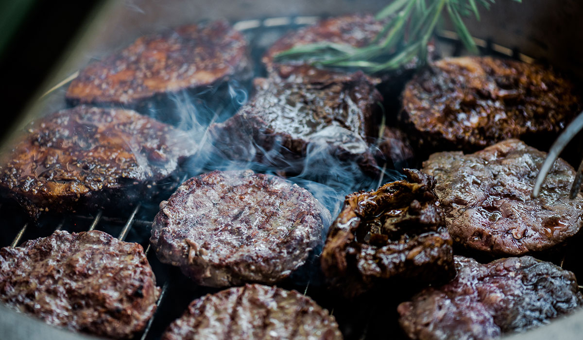 burgers on a grill image via shutterstock