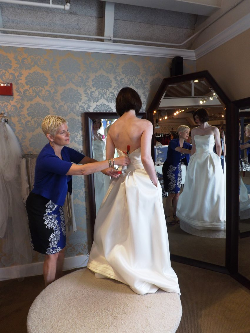 A bride-to-be tries on a dress at a 2013 Brides Across America event at Bella Sera Bridal. / Photo courtesy of Bella Sera Bridal