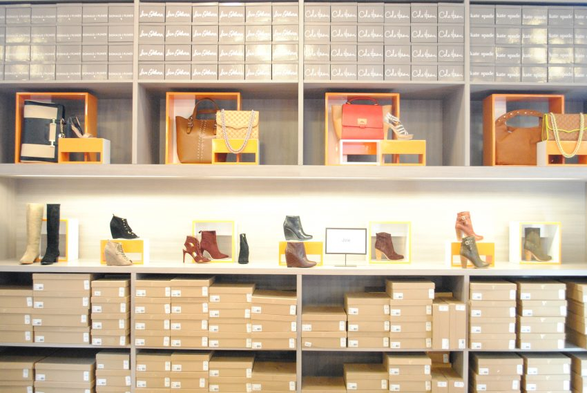 Shoes displayed along the wall / Photo by Alex Stoller.