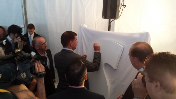 Boston Mayor Marty Walsh signs giant