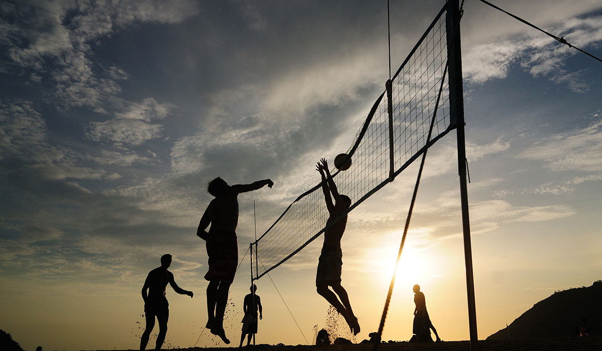 beach volleyball photo via shutterstock.