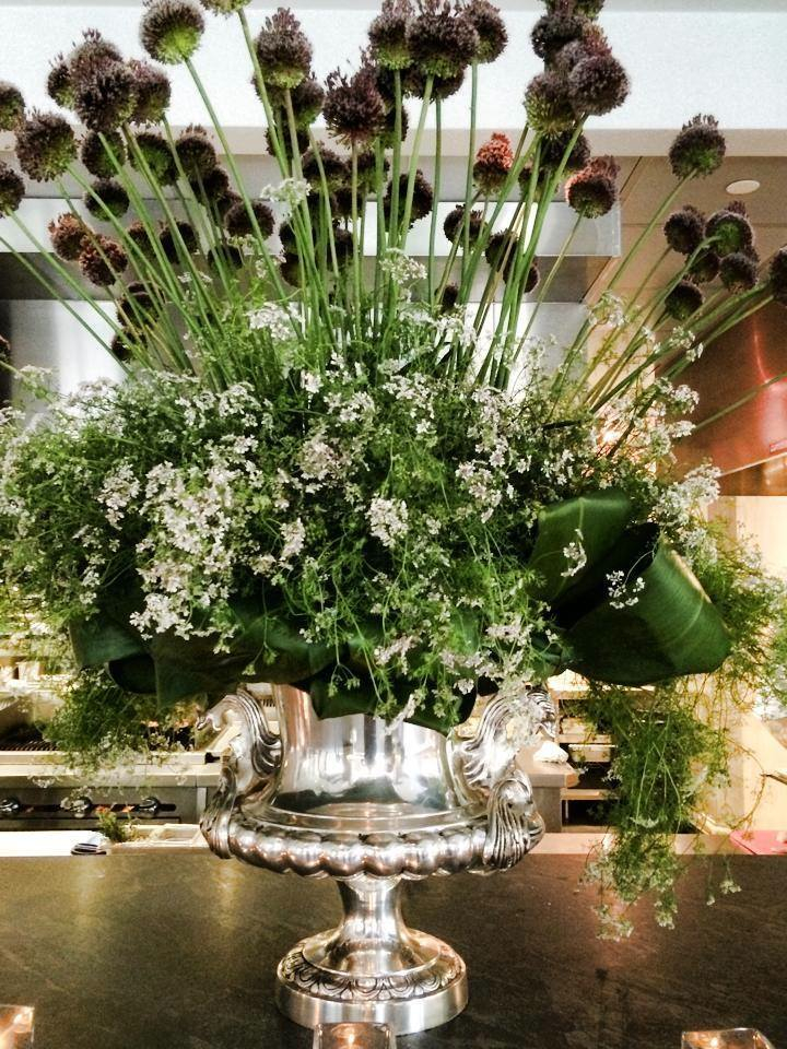 Marc Hall's arrangement of edibles for Liquid Art House restaurant and gallery space features allium, cilantro and tea leaves. Photo provided.