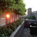 The sun sets on a rooftop in the South End designed by Marc Hall. Photo provided.