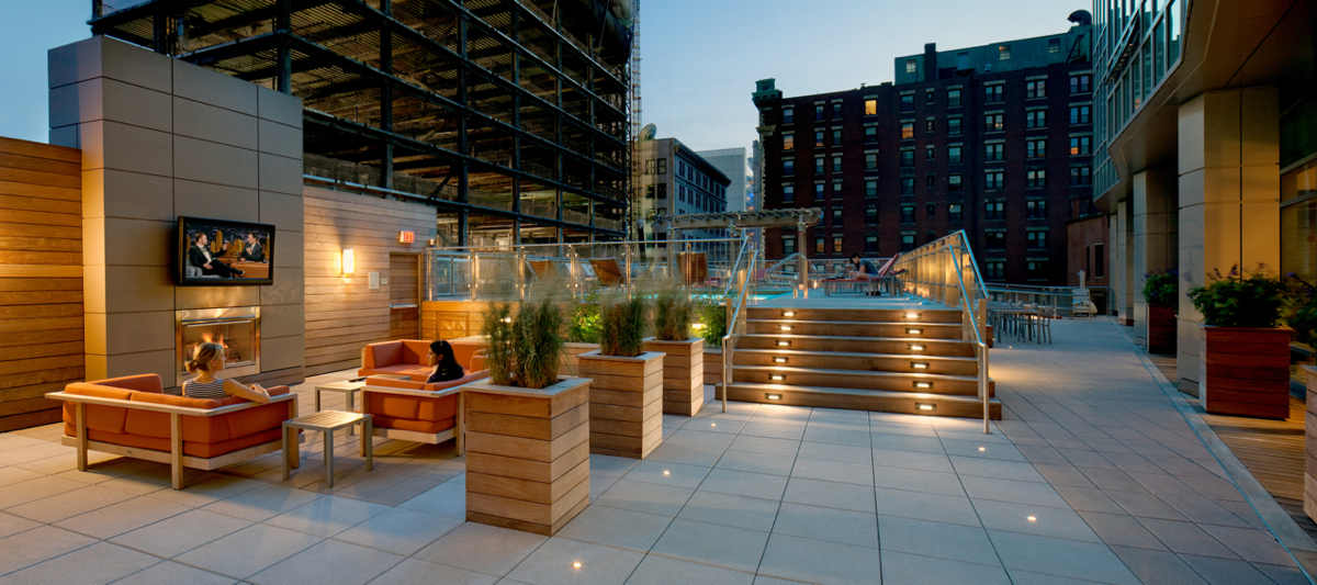 THE DECK AT THE KENSINGTON FEATURES A TIERED SPACE WITH OUTDOOR TVs AND A POOL. PHOTO BY ANTHONY CRISAFULLI.