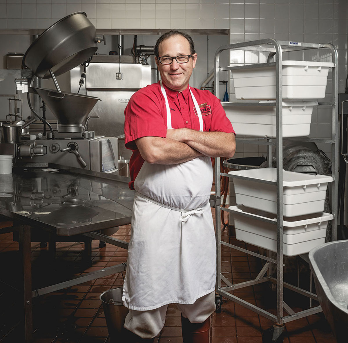Co-owner Bob Gokey shows off the sausage-making arsenal inside Karl's kitchen. Photo by Toan Trinh.