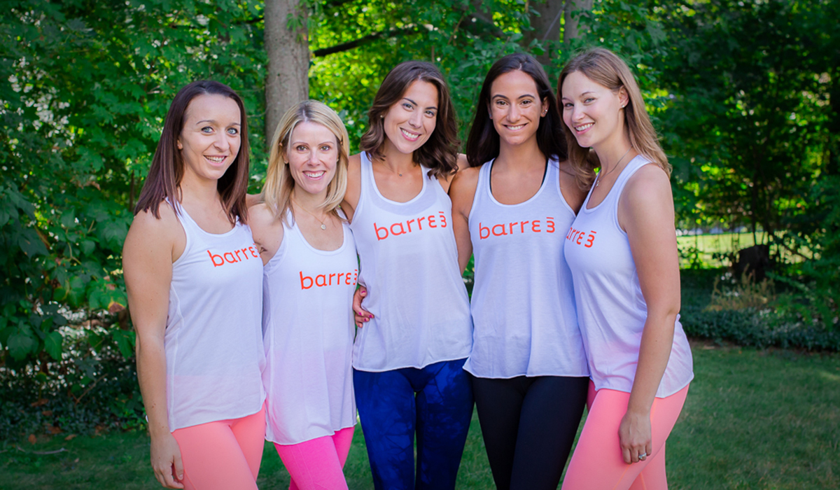The needham barre3 team, with owner Tina fey in the middle.