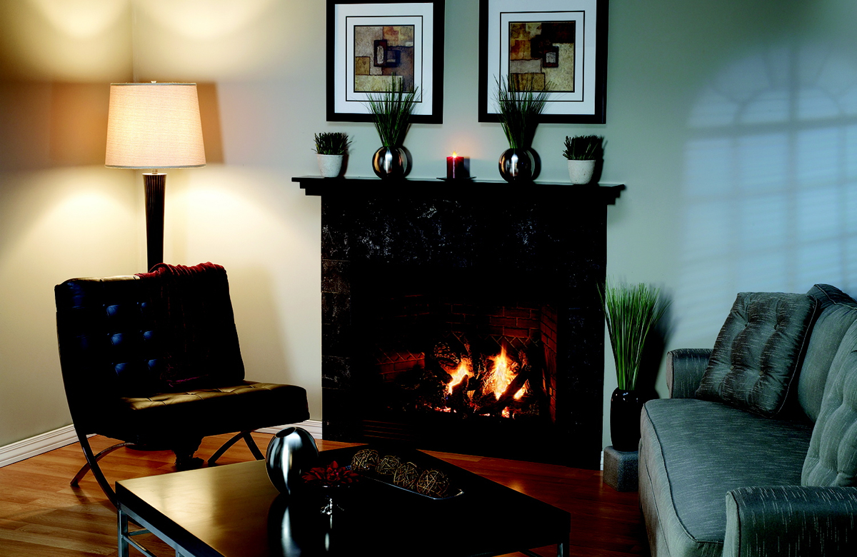 A TAHOE LUXURY DIRECT-VENT FIREPLACE WITH CUSTOM MANTELSHELF AND SLATE TILE SURROUND. PHOTO PROVIDED.