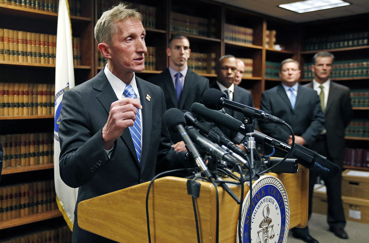 Boston Police Commissioner William Evans speaks at a news conference in Boston, Thursday, May 15, 2014. (AP Photo/Elise Amendola)