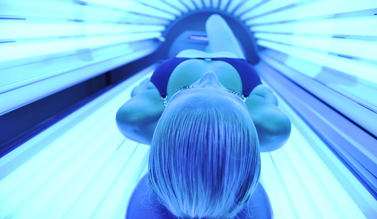 Tanning bed image via shutterstock