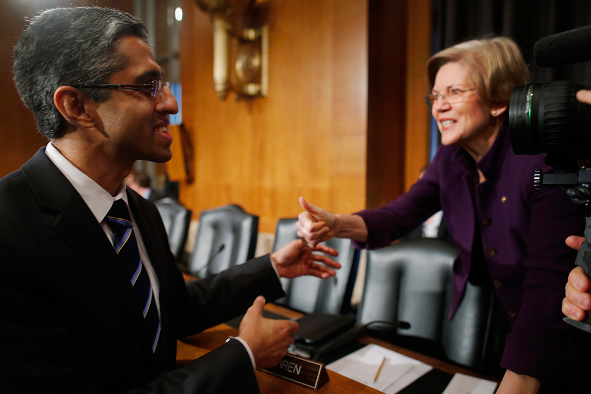 Dr. Vivek Murthy, President Barack Obama's nominee to be the next U.S. Surgeon General, greets Sen. Elizabeth Warren, D-Mass., before he testifies during his confirmation hearing before the Senate Health, Education, Labor, and Pensions (HELP) Committee on Capitol Hill in Washington, Tuesday, Feb. 4, 2014. (AP Photo/Charles Dharapak)
