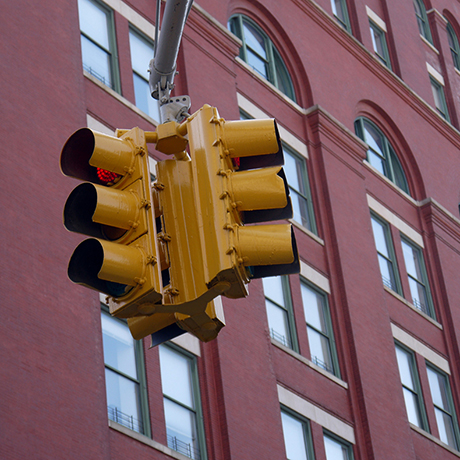 yellow traffic arrow