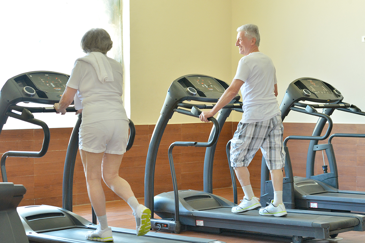 Senior couple on treadmills image via shutterstock