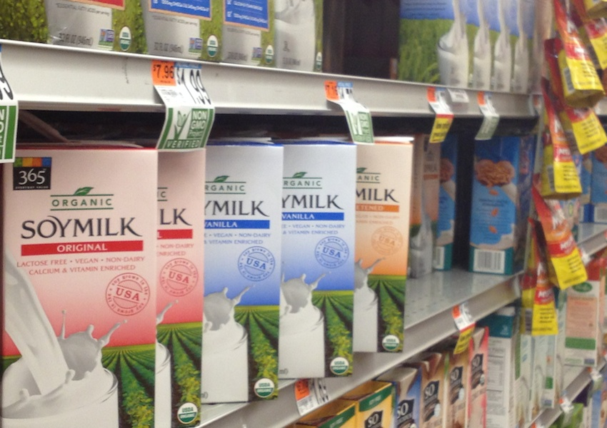 NON-DAIRY MILKS AT WHOLE FOODS. PHOTO BY JAMIE DUCHARME