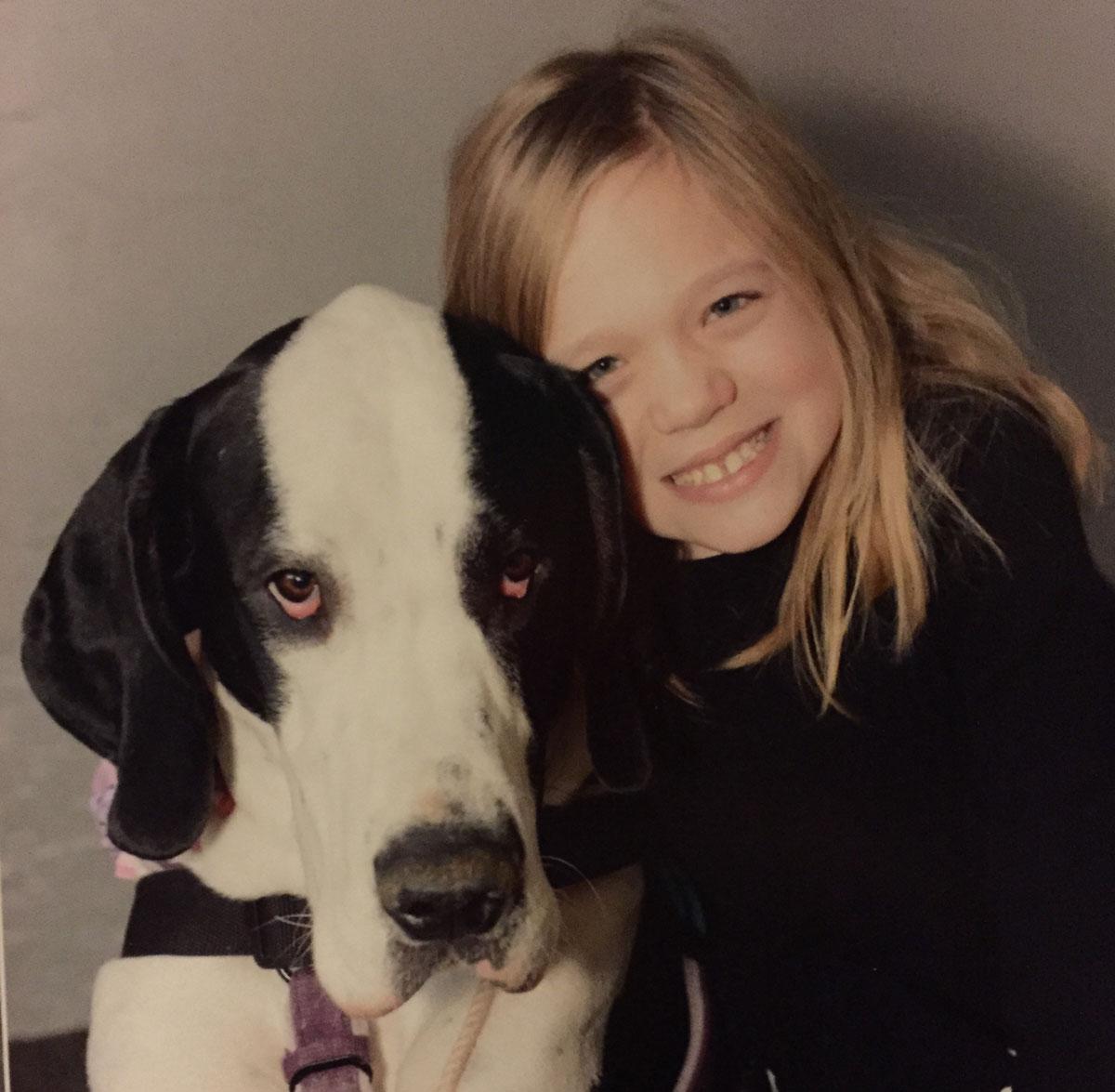bella burton and her guide dog, George. photo provided to bostonmagazine.com.