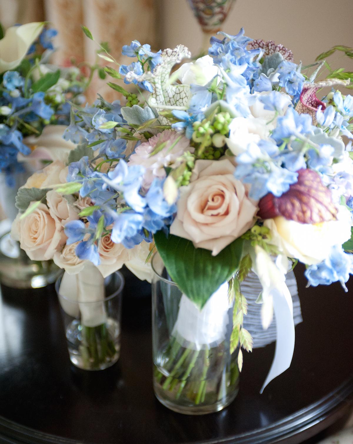 This garden style bouquet features blush roses, hosta, sarracenia, sea oats, delphinium, sahara roses and symphoricarpos berries; Photo courtesy of Winston Flowers