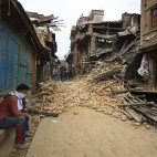 A Nepalese man mourns as he sits near the debris after an earthquake in Bhaktapur near Kathmandu, Nepal, Sunday, April 26, 2015. A strong magnitude 7.8 earthquake shook Nepal's capital and the densely populated Kathmandu Valley before noon Saturday, causing extensive damage with toppled walls and collapsed buildings, officials said. (AP Photo/Niranjan Shrestha)