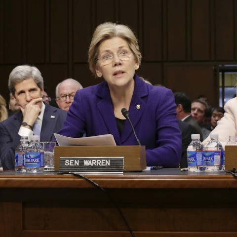 Sen. Elizabeth Warren, D-Mass., center, accompanied by Secretary of State Hillary Rodham Clinton, right, make statements introducing Senate Foreign Relations Chairman Sen. John Kerry, D-Mass., seated at left, to the committee during his confirmation hearing to become  secretary of state, replacing Clinton, Thursday, Jan. 24, 2013, on Capitol Hill in Washington.   (AP Photo/J. Scott Applewhite)